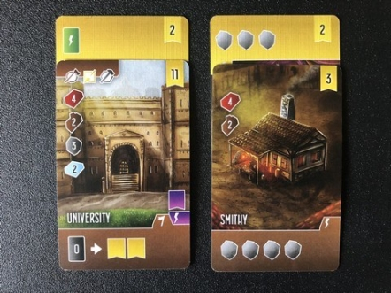 The University adornment gets you a new building card and 2 more points! The Smithy adornment gets you three stone immediately and also 2 more points.